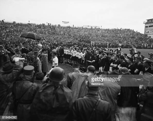 7/7/1954Bern Switzerland Jules Rimet the elderly and honorary President of FIFA hands the World Championship Cup to exhausted team captain Fritz...