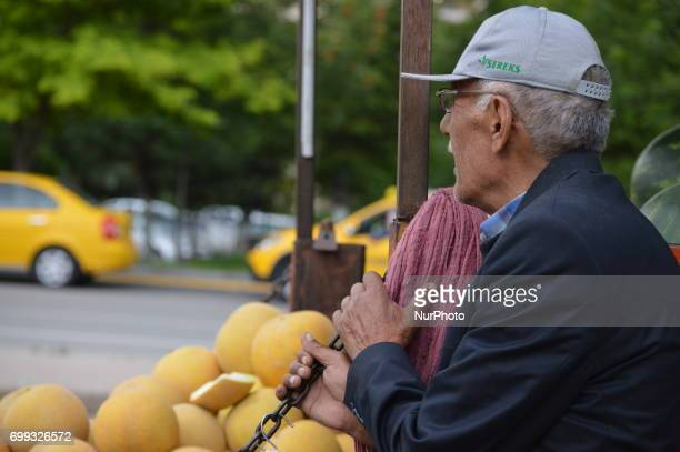 77yearold peddler is pictured in front of his truck in Ankara Turkey on June 21 2017 60 and 77yearold two peddlers sell melons and watermelons on...