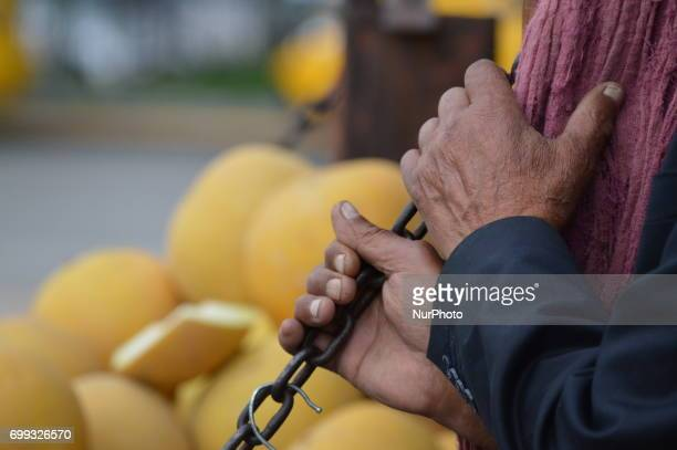 77yearold peddler's hands are pictured in front of his truck in Ankara Turkey on June 21 2017 60 and 77yearold two peddlers sell melons and...