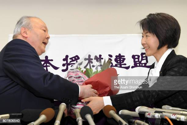 77yearold professional shogi player Hifumi Kato receives a flower bunch during his retirement press conference at Shogi Kaikan on June 30 2017 in...