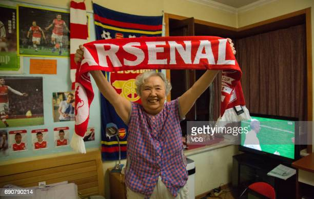 78yearold gooner Liu Hongwen cheers for Arsenal after the FA Cup Final between Arsenal and Chelsea at home on May 28 2017 in Beijing China 78yearold...