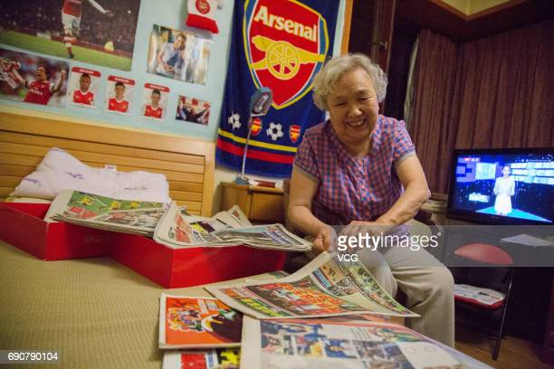 78yearold gooner Liu Hongwen introduces her collection of clippings of Arsenal at home on May 27 2017 in Beijing China 78yearold retired teacher Liu...