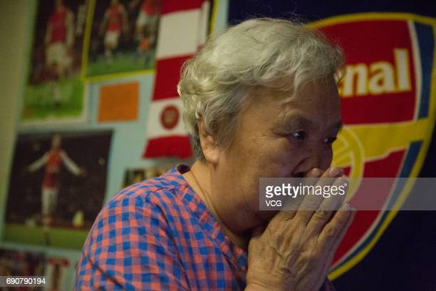 78yearold gooner Liu Hongwen watches FA Cup Final between Arsenal and Chelsea at home on May 28 2017 in Beijing China 78yearold retired teacher Liu...