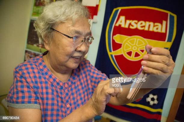 78yearold gooner Liu Hongwen writes a Weibo after Arsenal winning the FA Cup Final at home on May 28 2017 in Beijing China 78yearold retired teacher...