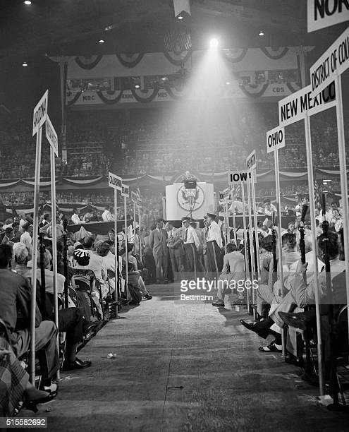 This unusual photo shot down the center aisle between the standards of the States shows General Douglas MacArthur on the rostrum as he began his...