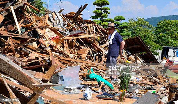 79yearold Yoshimasa Fukumoto stands in front of the place his house used to stand where he lost daughterinlaw two months after earthquakes on June 14...