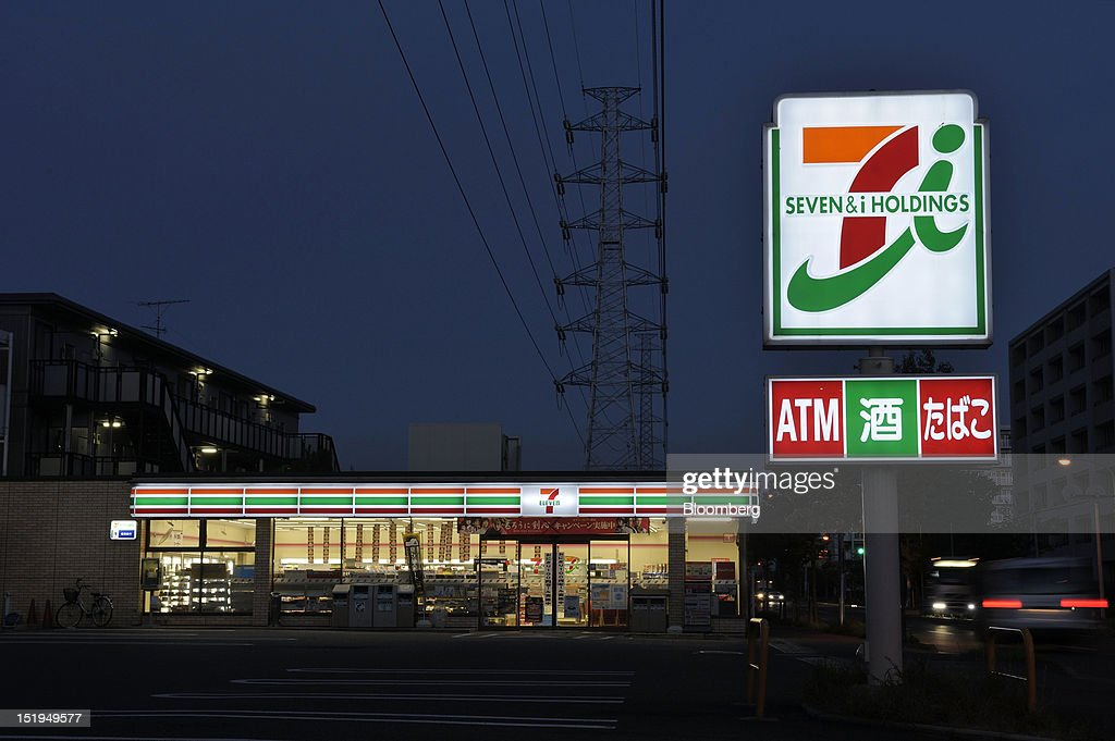 A 7-Eleven convenience store, operated by Seven & I Holdings Co., stands at night in Yokohama City, Kanagawa Prefecture, Japan, on Tuesday, Sept. 11, 2012. Sales at Japan's convenience stores declined 3.3 percent in July from a year ago on a same-store basis, according to the Japan Franchise Association. Photographer: Akio Kon/Bloomberg via Getty Images