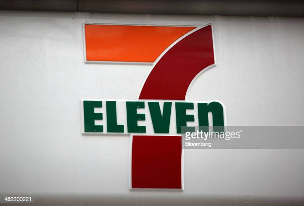 A 7Eleven logo is displayed outside one of the convenience stores operated by Seven I Holdings Co in Tokyo Japan on Thursday April 3 2014 Seven I...