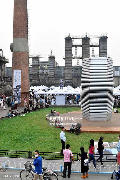 A 7metertall air purifying tower is installed at a park on October 2 2016 in Beijing China The 'world's largest' purifier enables to clean 30000cubic...