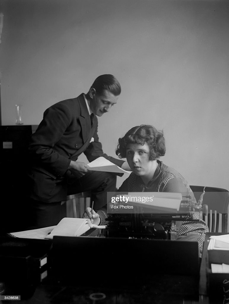 Sitting at her desk, Miss Agnes Hicks contemplates the meaninglessness of her office job.