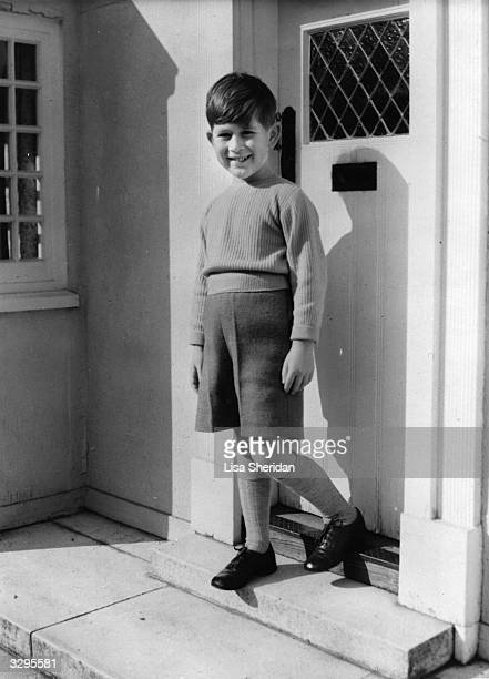 Prince Charles at the door of The Welsh House a miniature house donated to Princesses Margaret Rose and Elizabeth by the people of Wales in the...