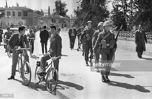 The net closes on EOKA terrorists in the mountainous districts of Cyprus as British patrol the villages following the failure of intergovernmental...