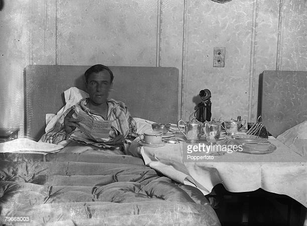 7th August 1931 MrJAMollison enjoys breakfast in bed after his record breaking 11000 miles flight from Australia to London in eight days twenty two...