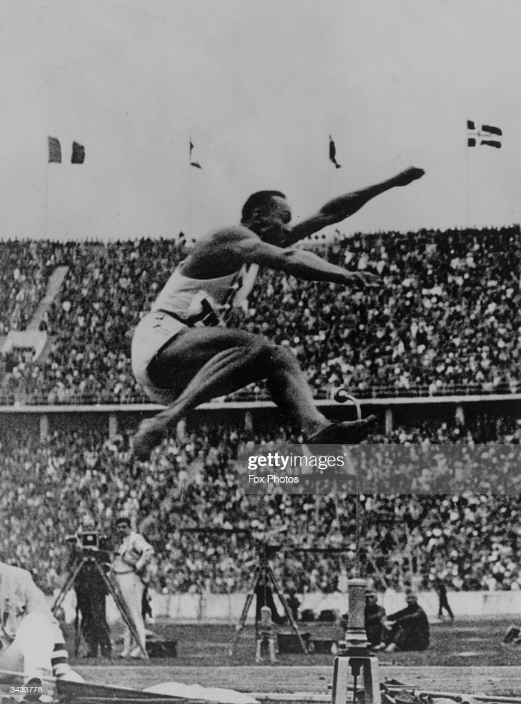 Jesse Owens (1913 - 1980), who smashed so many records at the German Olympics in 1936 that Hitler refused to meet him, in the final of the long jump, Berlin.