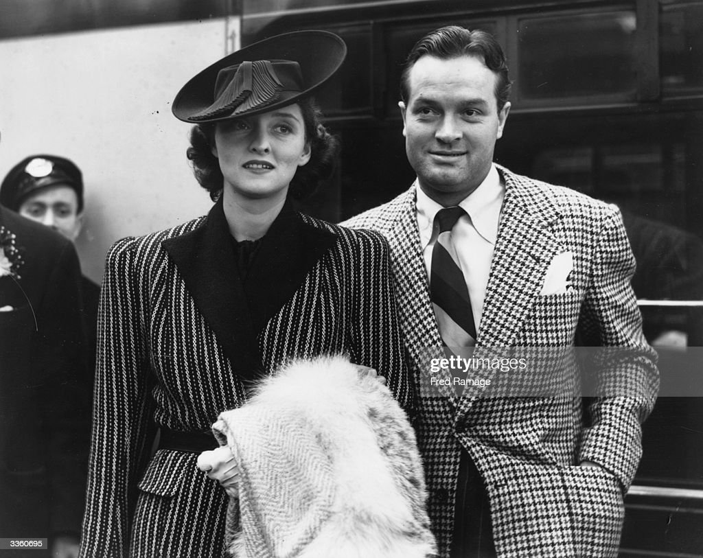 American comic and film actor Bob Hope (1903 - 2003) and his wife Dolores arrive at London's Waterloo Station on the Normandie boat train.