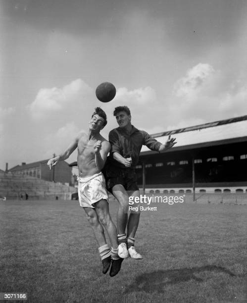 Fulham Captain Johnny Haynes and Jimmy Hill train at Craven Cottage in readiness for the new season