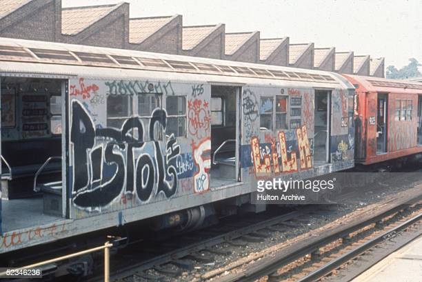 View of a New York City subway train covered in graffiti and park with all its doors open in an unidentified station New York 1980s The train is a...