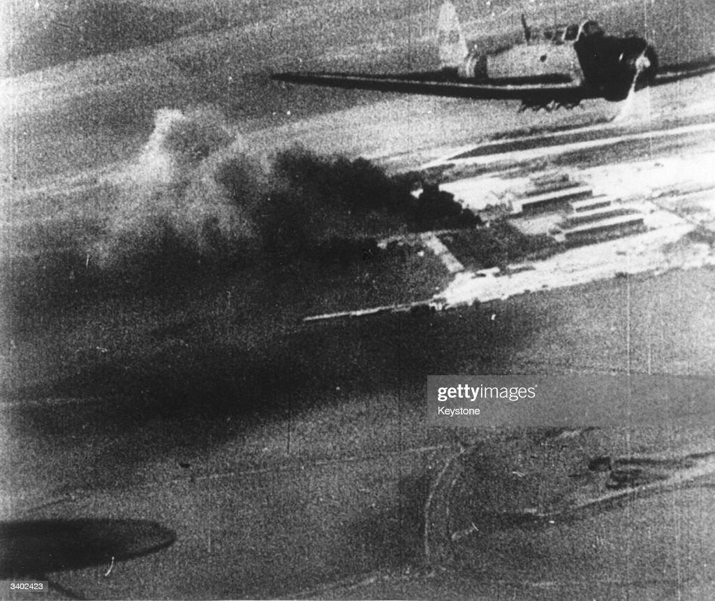 A picture taken from a Japanese bomber showing another Japanese plane and plumes of black smoke on the ground during the attack on Pearl Harbour (Pearl Harbor).