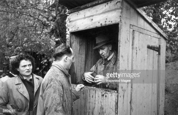 A Bath Rugby Club committee member issues tickets at the gate before a match Original Publication Picture Post 4269 The Life Of A Rugby Club pub 1946