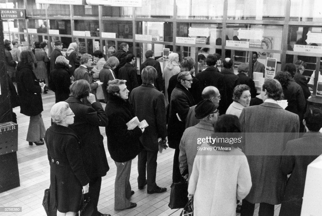 Motorists queue at the Post Office in Trafalgar Square, London, to collect their petrol coupons during the petrol shortage crisis of 1973.