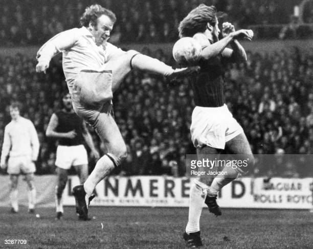 Leeds United captain Billy Bremner leaps high to kick the ball as West Ham United's Graham Paddon attempts a block during a league match at Upton Park
