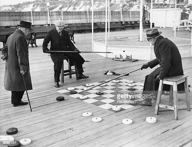 A game of deck draughts in progress at Bournmouth Pier