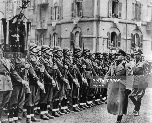 Benito Mussolini inspects the fully armed police 'shock troops' of the Fascist Militia during celebrations in Rome of the 17th aniversary of their...