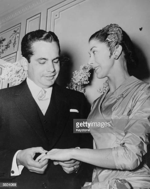 Diplomat Roberto Emilio Arias Panamanian ambassador to Britain places Margot Fonteyn's wedding ring on her finger on their wedding day at the...