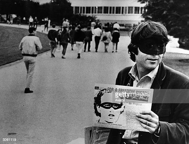 Berkeley University student Darrow Bishop selling copies of the Berkeley Barb a student protest paper wearing a Lone Ranger mask as part of the...
