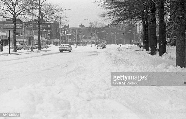 Vehicles drive down a snow covered Woodhaven Boulevard in Queens NY the day after the Blizzard of 1978