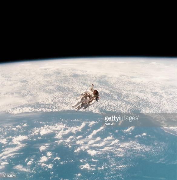 Astronaut Bruce McCandless II during the first untethered spacewalk made possible by his nitrogen jet propelled backpack