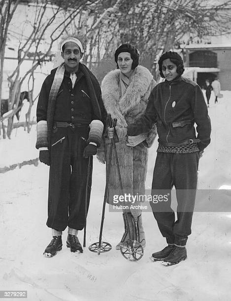 The exMaharajah of Indore with his wife and daughter at a Swiss resort