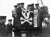 Waving a Jolly Roger the crew of the submarine Thrasher on their return to port after a successful foray against enemy ships She was known as the...