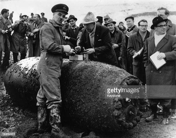 RAF Flight Lieutenant James Waters and Walther Mitzke defuse a giant bomb which was dropped in the 1944 dambusters raids in Landsheim West Germany
