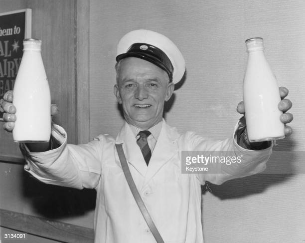 Mr George Jones of Llandudno is voted Personality Milkman of 1964 and comes to receive his prize at the National Dairy Centre in Charing Cross Road...