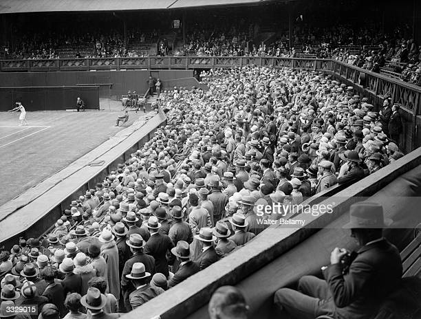 Spectators in the stands around the Centre Court at Wimbledon during the tennis championships