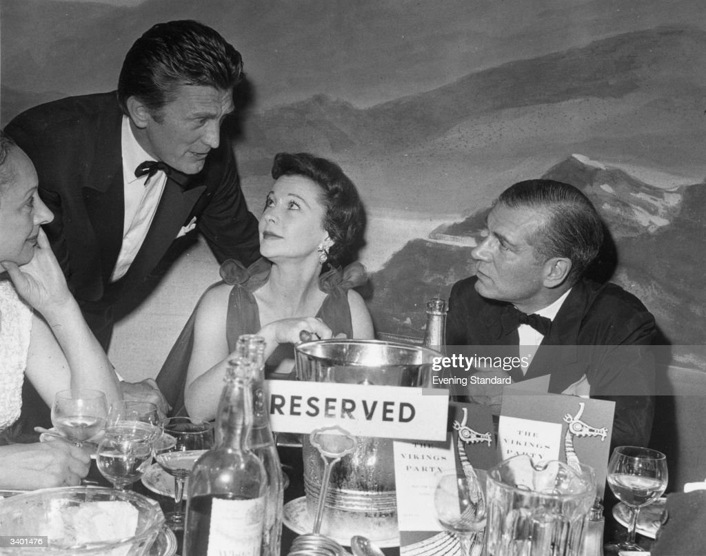 Actor Kirk Douglas talks to Lord and Lady Olivier, British actress Vivien Leigh (1913 - 1967), at the Mayfair Hotel.