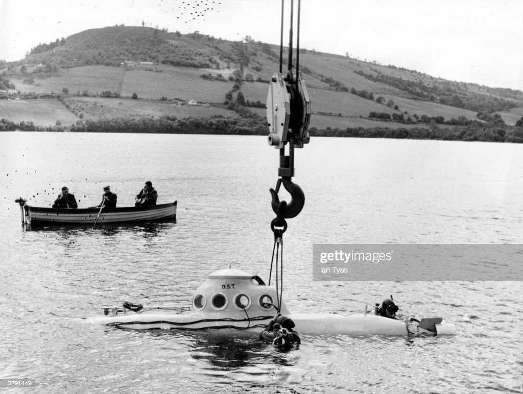 A submarine is lowered into Loch Ness to begin its search for the monster References to a monster in Loch Ness date back to St Columba's biography of...