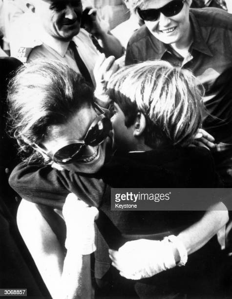 Jackie Onassis receives an enthusiastic hug from her son John Jr affectionately known as John John during their reunion at Athens airport
