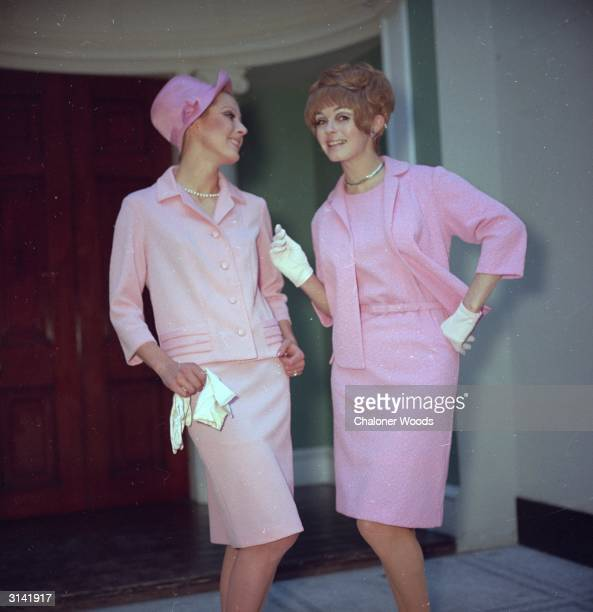 Two ladies both dedicated followers of fashion wear pale pink outfits and chat about how fabulous life is