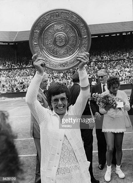 American tennis champion Billie Jean King holds her trophy aloft after her win over Evonne Goolagong in the final of the Womens Singles at Wimbledon