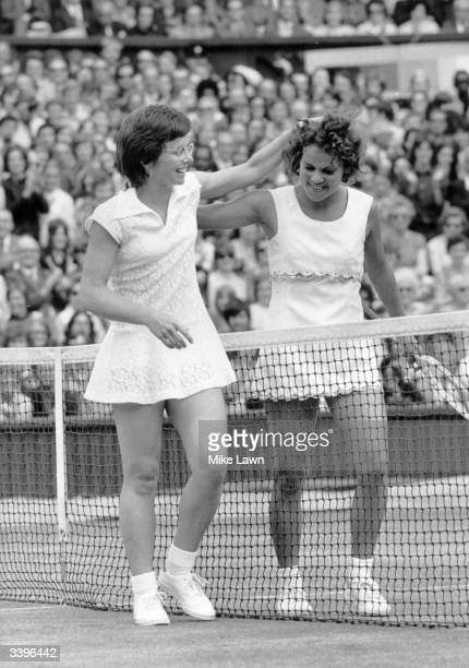 American tennis player Billie Jean King and Australia's Evonne Goolagong on Wimbledon's Centre Court after Billie Jean King had won the women's...