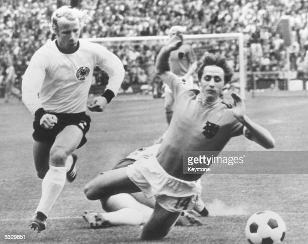 Johan Cruyff falls whilst playing for Holland in a World Cup Final in Munich West Germany won the match with two goals against one