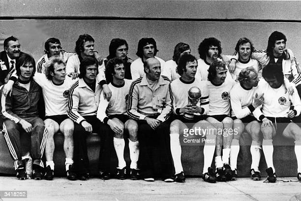 The West Germany football team with their manager Helmut Schoen after winning the World Cup Final against Holland in Munich Captain Franz Beckenbauer...