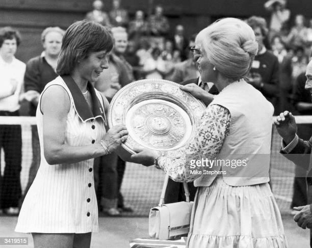 American tennis player Martina Navratilova receiving the Ladies Singles Trophy from the Duchess of Kent after winning at Wimbledon