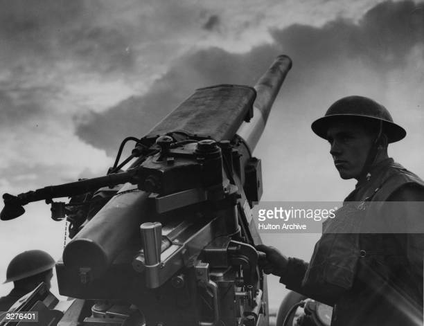 A typical antiaircraft gunner at the trigger of his 37 inch gun