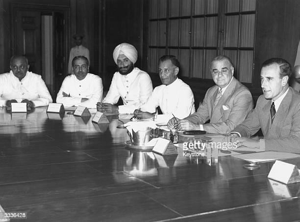Lord Mountbatten Viceroy of India presenting representatives of India with Britain's plan for the partition of the country the Jamasahib of Nawahagar...