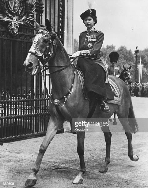 Princess Elizabeth as Colonel of the Grenadier Guards after taking the salute of the Brigade of Guards In ceremonial dress she appears on behalf of...