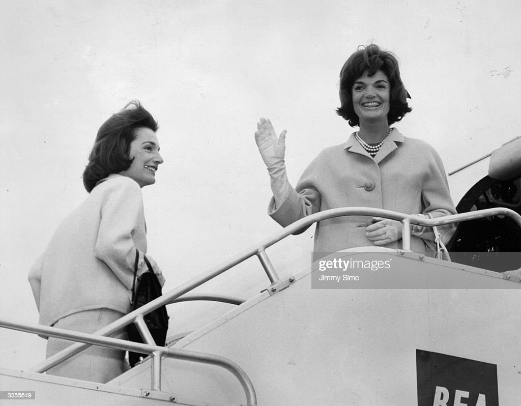 Jackie Kennedy (1929 - 1994), wife of president John F Kennedy, boards a BEA aeroplane at London airport. Accompanying her on the flight to Athens is her sister Lee Radziwill.