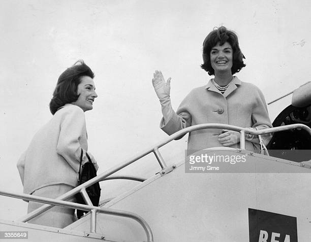 Jackie Kennedy wife of president John F Kennedy boards a BEA aeroplane at London airport Accompanying her on the flight to Athens is her sister Lee...
